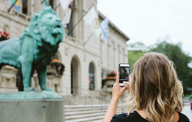 Woman taking a picture of a museum near the Chicago Marriott Downtown Magnificent Mile