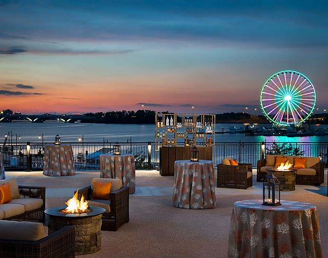 Gaylord National Orchard Terrace overlooking Potomac River and National Harbor at sunset