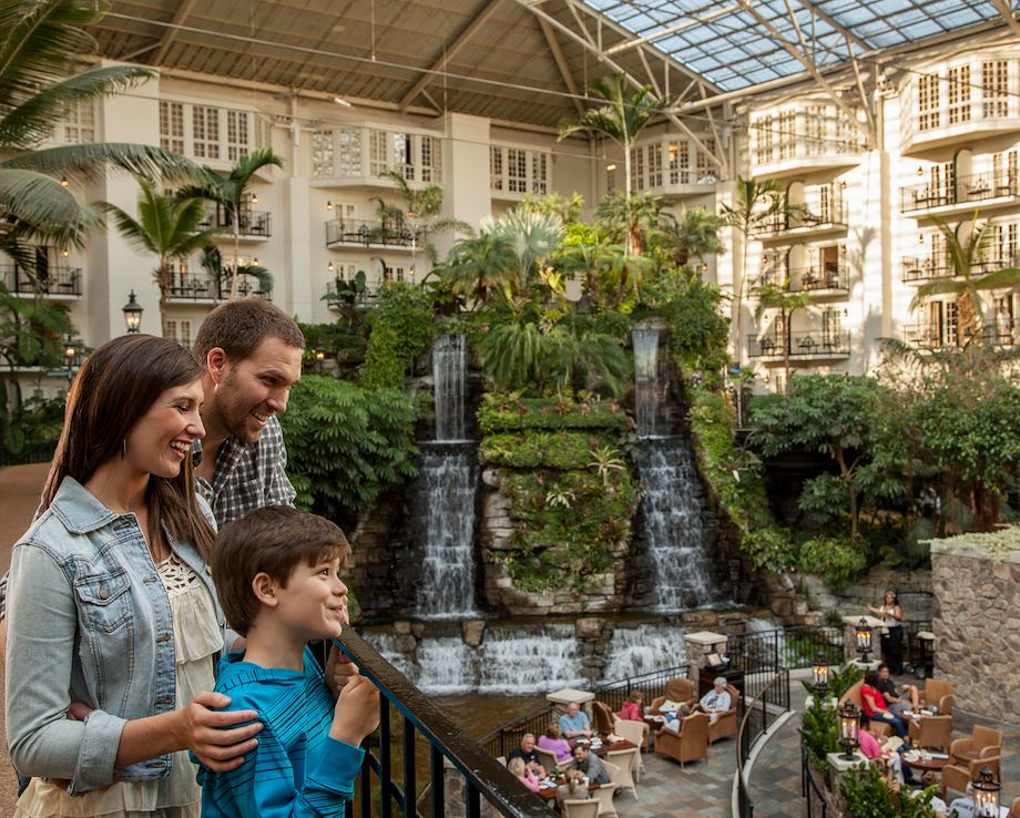 Family overlooking Cascades Restaurant at Gaylord Opryland
