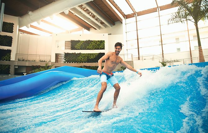 Male Guest on FlowRider attraction at SoundWaves