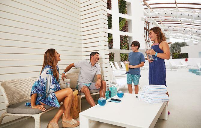Family inside SoundWaves Cabana