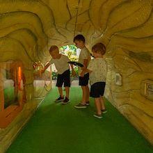 3 Kids in log tunnel at Gaylord Opryland Resort in Nashville, TN
