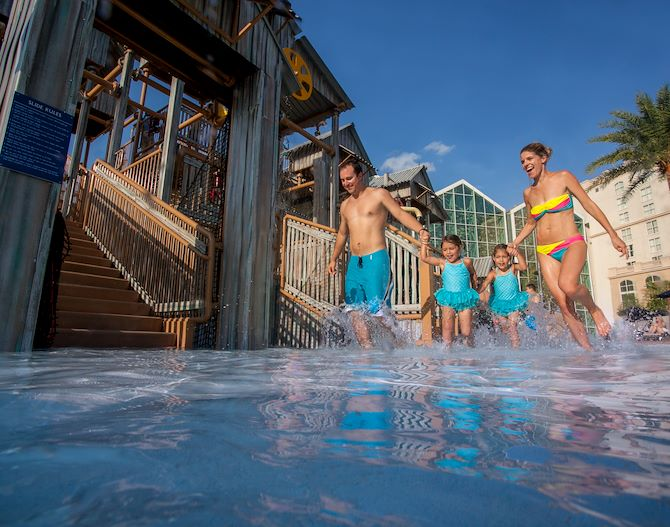 Family in water holding hands at Cypress Springs Water Park - Gaylord Palms