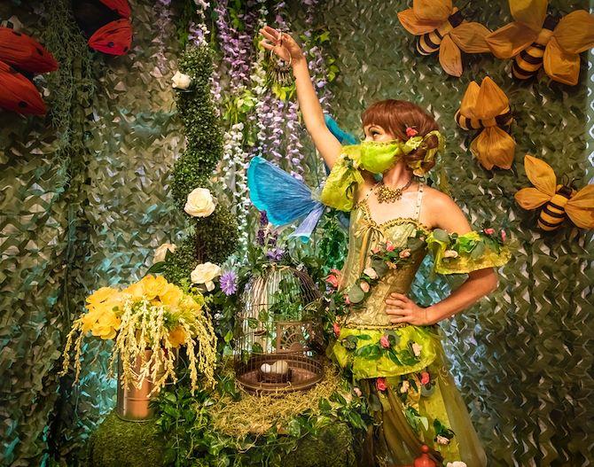Character in costume in enchanted garden