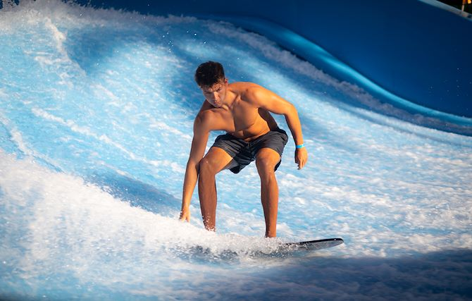 Guest on Flowrider Attraction at Gaylord Palms
