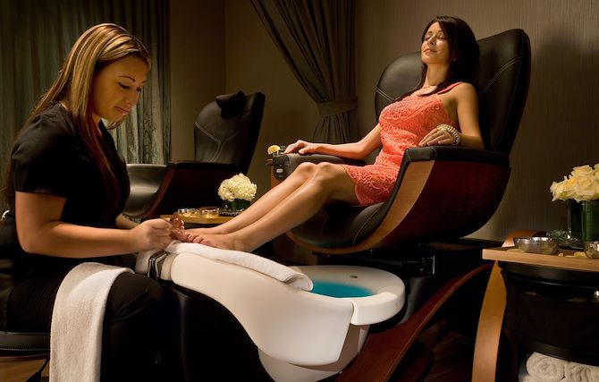 Woman getting pedicure at Relache Spa at Gaylord Palms