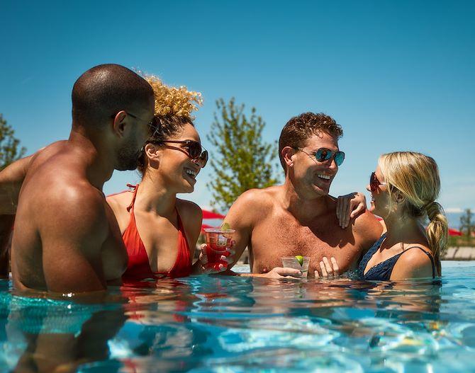Guest in Arapahoe Springs Pool at Gaylord Rockies Resort in Aurora, CO