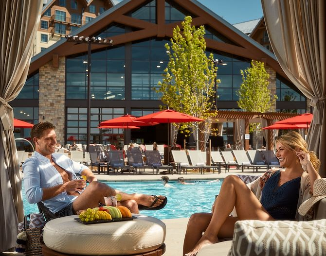 Couple in Private Cabana at Arapahoe Springs at Gaylord Rockies Resort in Aurora, CO
