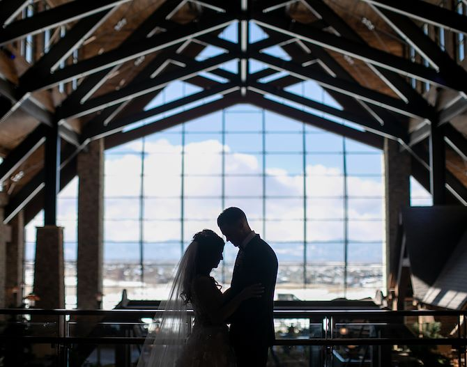 Couple in an embrace in Grand Lodge at Gaylord Rockies Resort in Aurora, CO