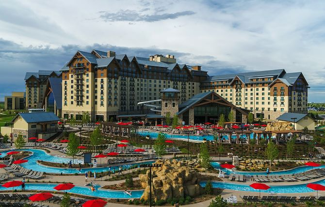 Gaylord Rockies Resort exterior with Arapahoe Springs Lazy River in foreground