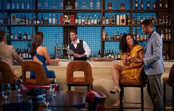 Guests at bar at Old Hickory Steakhouse at Gaylord Rockies