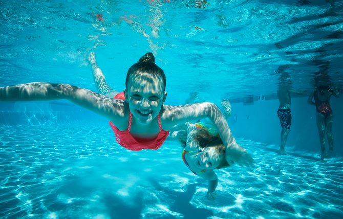 Kids underwater in pool at Gaylord Rockies