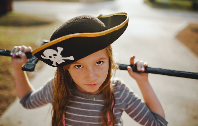 Girl in pirate hat with sword at Gaylord Rockies