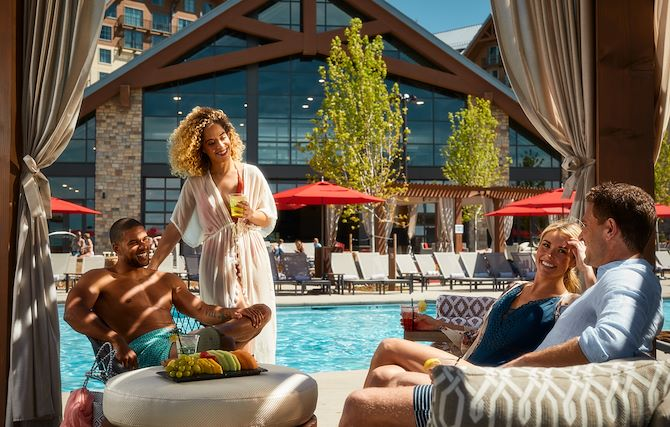 Family inside private cabana at Arapahoe Springs at Gaylord Rockies Resort in Aurora, CO