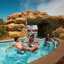 Family in tubes on Lazy River at Arapahoe Springs at Gaylord Rockies