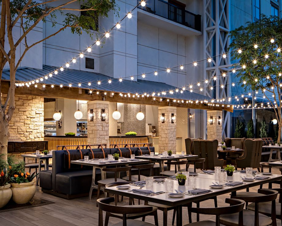 Patio in lights at Zeppole inside atrium at Gaylord Texan