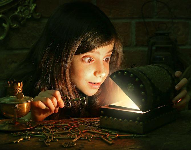 Girl opening treasure chest