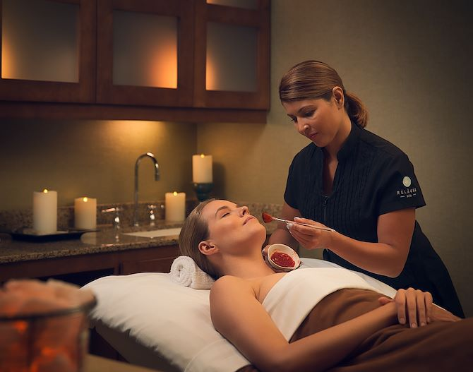 Woman getting treatment at Relache Spa at Gaylord Texan
