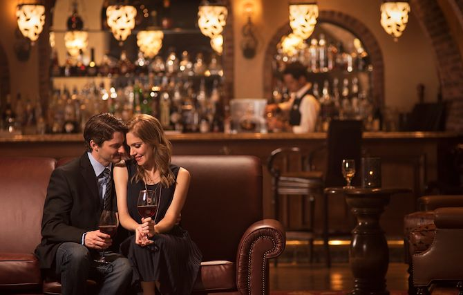 Couple on couch in front of bar at Old Hickory Steakhouse at Gaylord Texan