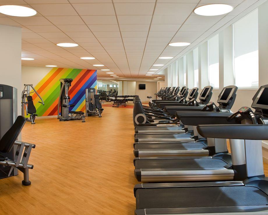 Row of treadmills inside of a gym