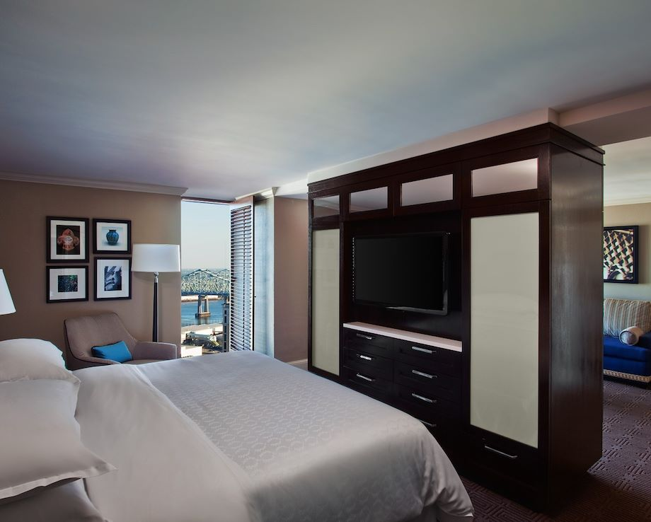 Image of a double bed witha tv in front of it
