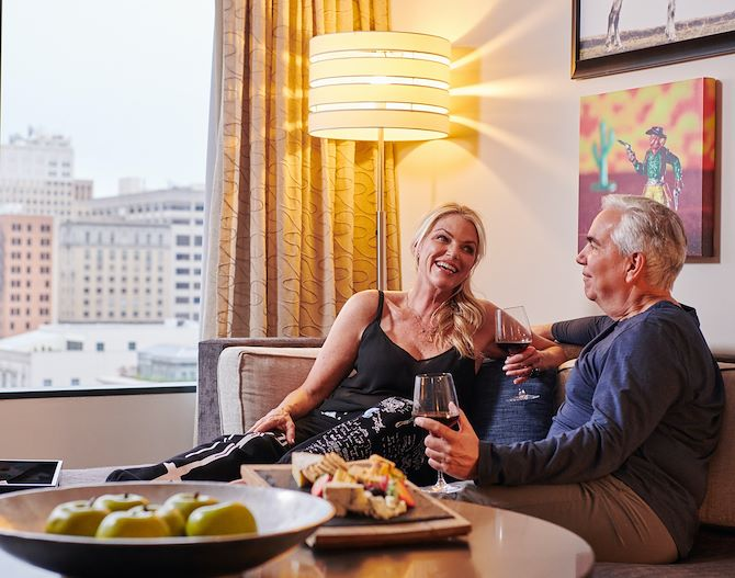 Couple Enjoying Light Bites in Their Room at The Worthington Renaissance Fort Worth Hotel
