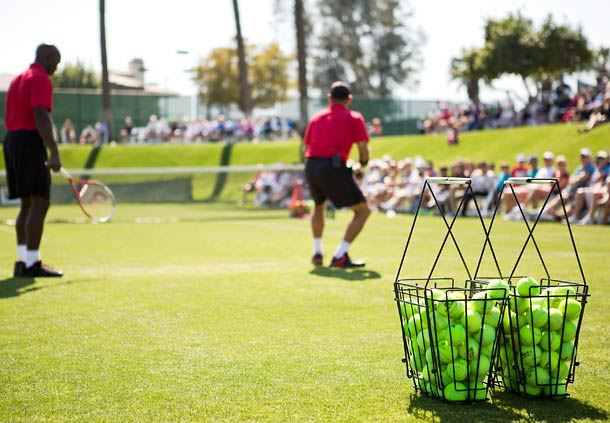 Tennis Match on the Greens