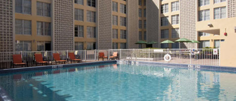 Enjoy a day under the sun in our outdoor swimming pool.