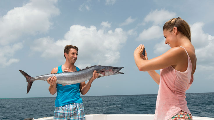 Couple deep sea fishing